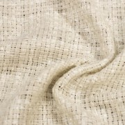 リボンのような糸が縦横に織り込まれているのが特徴的な生地。(28034-1)