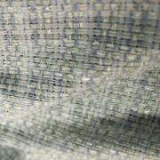 リボンのような糸が縦横に織り込まれているのが特徴的な生地。(28034-2)